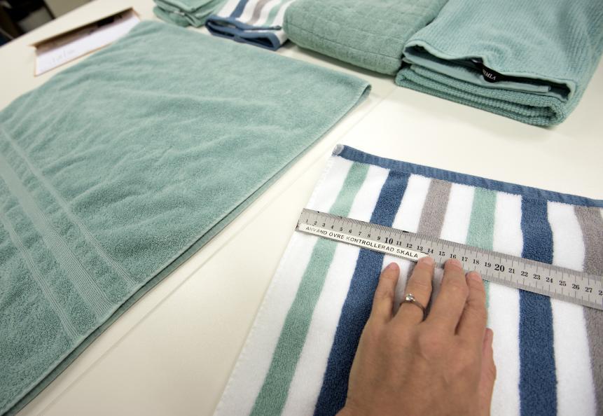Testfakta testar av dusjhåndklær